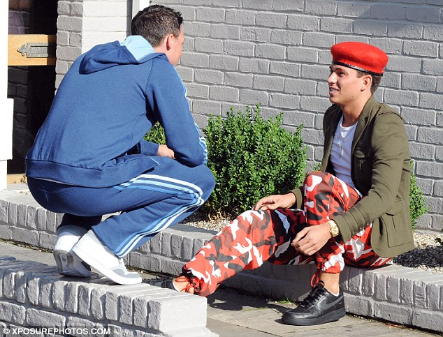 What ARE you wearing? Joey Essex wore army fatigues and a red beret for the coach trip - and even had best friend Kirk questioning his attire
