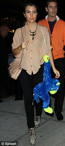 Casual cutie: Sister Kourtney went for a more casual approach but still wore towering heels