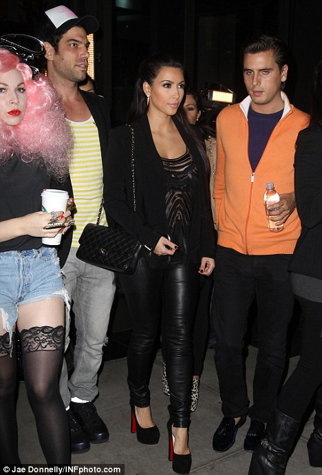 Strike out! Kim's bra was clearly on show for all to see as she stepped out with her sister Kourtney, brother-in-law Scott Disick and some other friends