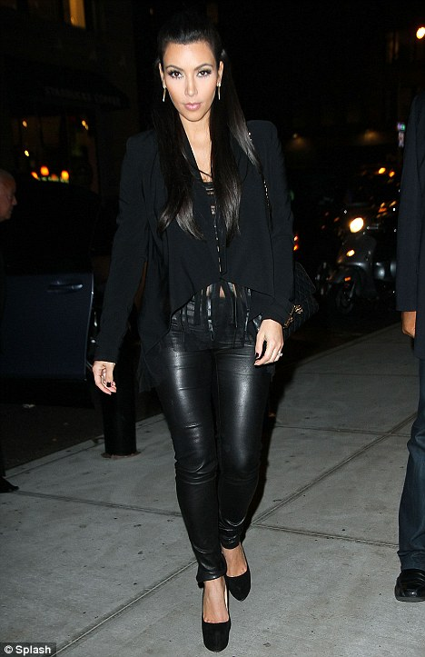 Odd choice: While Kim looked ultra chic in an all black ensemble, which included towering Christian Louboutin heels, the outfit seemed hardly appropriate for the sporty endeavor