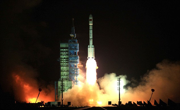 A Long March-2FT1 carrier rocket loaded with Tiangong-1 unmanned space lab module blasts off from the launch pad at the Jiuquan Satellite Launch Center in the Gobi Desert