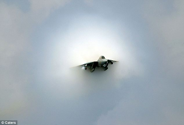 Plane-ly fast: The F14D Tomcat punches through the sound barrier, creating a dramatic cloud effect