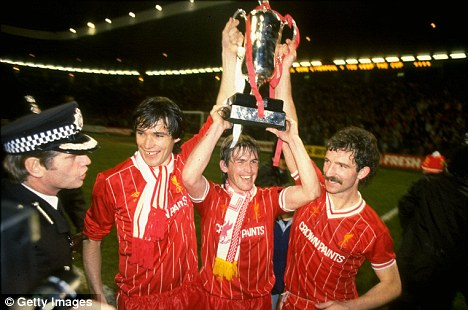 Up for the Cup: Dalglish celebrates as Liverpool win the 1984 Milk Cup Final against Everton
