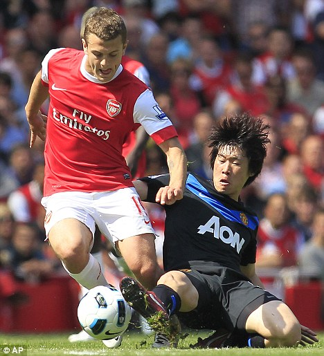 Star player: Jack, seen here with Manchester United's Ji-Sung Park, earns £50,000 a week at Arsenal