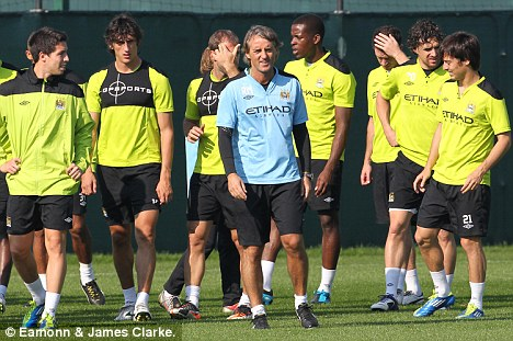 The man in charge: Mancini puts the City squad through their paces on Friday