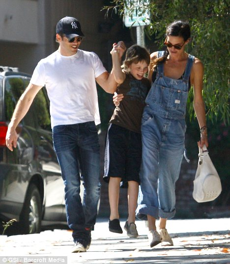 Happy family: Despite filing for divorce less than two weeks ago Lisa Linde and her husband James Marsden appear to be on extremely good terms as they enjoyed a day out with their son over the weekend
