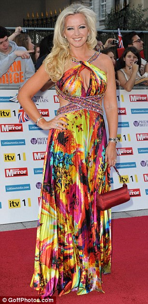 Good advert: Lingerie entrepreneur Michelle Mone (left) wore one of her own Ultimo Couture gowns, while TV presenter Nell McAndrew wore an equally colourful dress