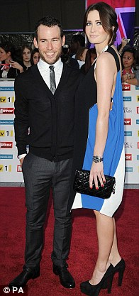 Height difference: Glamour model Peta Todd towers over her cycling champion boyfriend Mark Cavendish, comedian Ronnie Corbett arrives with wife Anne while Laurence Llewelyn-Bowen brought wife Jackie