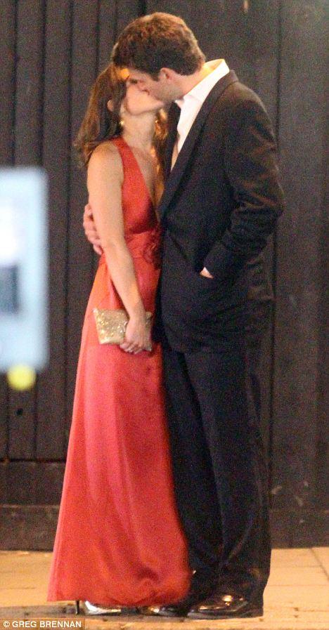 Smooching: The couple share a tender kiss