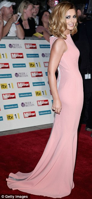 Pretty in pink: Cheryl Cole glows in a floor-length dusky pink gown and blonde curls as she arrives at the Pride Of Britain Awards at London's Grosvenor House Hotel
