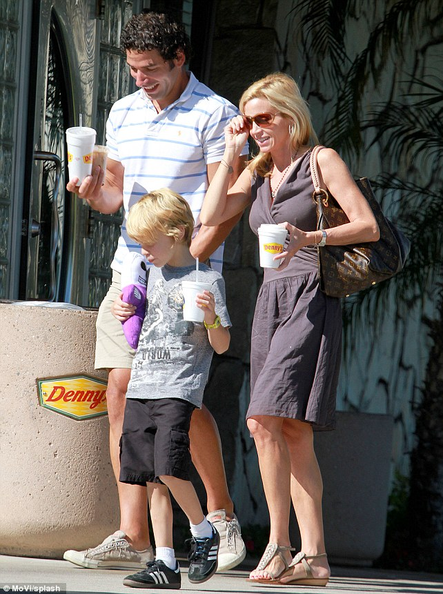 Father figure? Throughout the day, in pictures that are sure to rile her ex-husband Kelsey, Camille took Dimitri and son Jude to a local Denny's diner for some refreshments