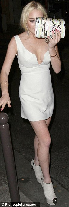 Party girl: Lindsay has been partying up a storm in the French capital in an array of designer outfits