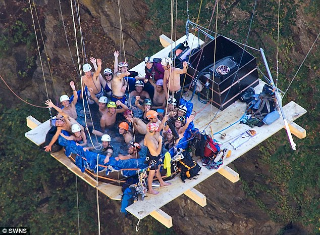 Party: The group, who kept warm using a gas powered system, celebrated with drinking champagne and eating cake