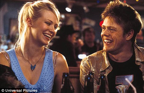 Big screen: Marshall also appeared in the hit film Love Actually. He is pictured here with actress Michelle Williams