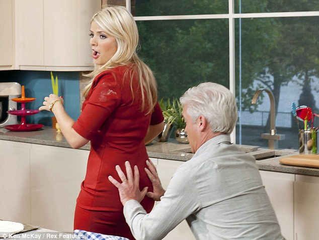 What a mess: Willoughby ended up with floury handprints on her Diane Von Furstenberg dress thanks to cheeky co-host Phillip Schofield on This Morning