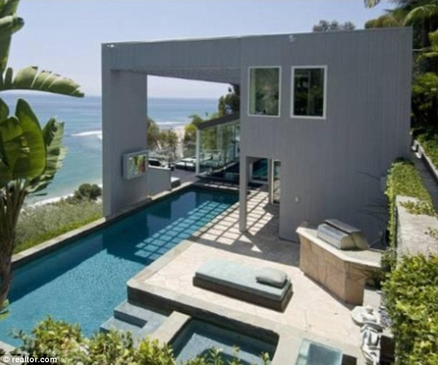 Back on the market: Matthew Perry has relisted his Malibu home for $12.5million, after slashing the asking price