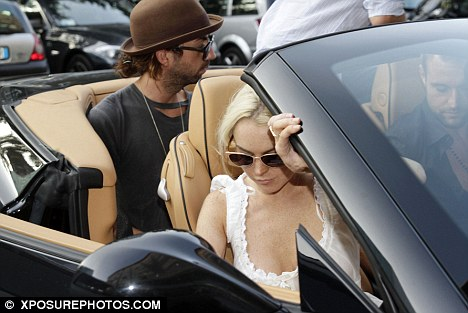 Pimp Her Ride: Lindsay enjoyed travelling in Phillip Plein's Ferrari in Milan, now she is reported to have her own sportscar