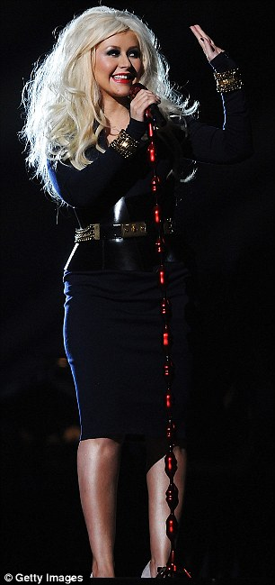 Costume change: Christina swapped into a more demure dress which featured military detailing