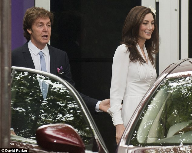 Dashing groom: Sir Paul was seen offering a helping hand to his bride as they got into the car heading to their wedding