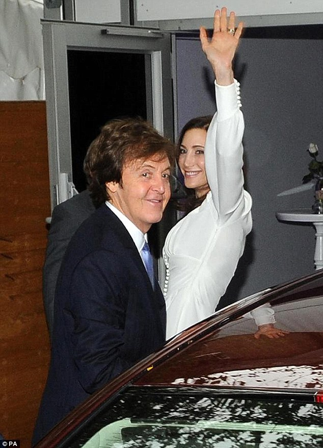 Returning home: Sir Paul McCartney and his new wife Nancy Shevell arrive at their north London home following their wedding at Westminster Registry Office