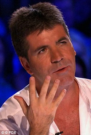 Switching off: While Simon Cowell is over is the U.S. launching the American version of the X Factor, back home viewers are switching off due to ad break overload