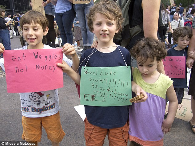 Banners: Children off school for Columbus Day enjoyed taking part in the protests in New York with adults