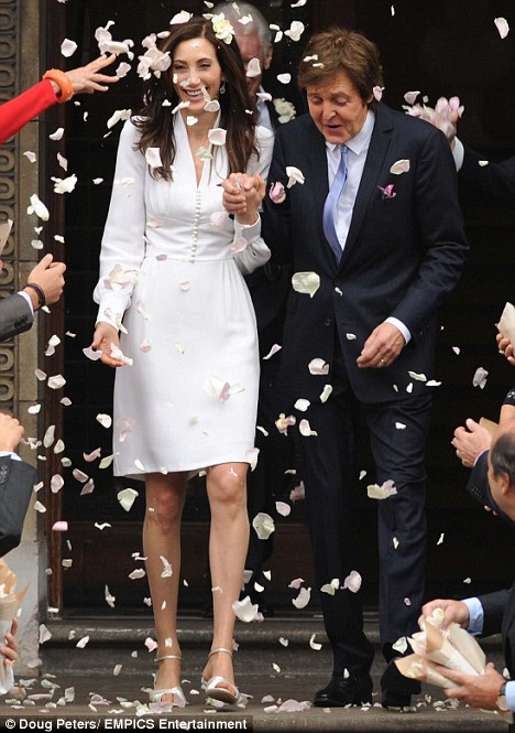The happy couple: Sir Paul and his new Lady leave Marylebone Town Hall after their low-key wedding on Sunday