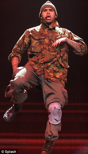 Second chance: Chris Brown performs as part of The F.A.M.E. Tour at the American Airlines Arena in Miami, Florida.