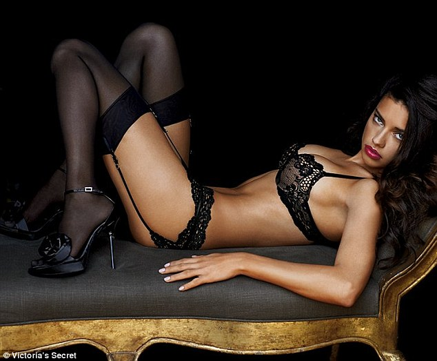Lovely in lace: Adriana Lima poses on a gold trimmed chaise longue for the new Victoria's Secret lingerie collection