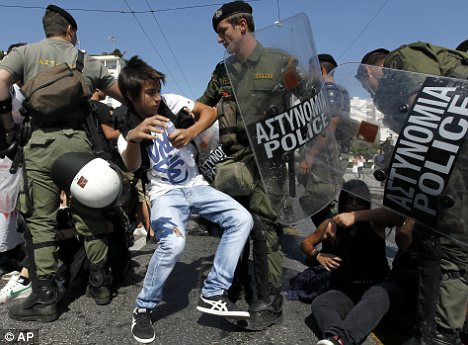 Clash: Despite ongoing protests over fiscal austerity in Greece, it has emerged than many people are claiming illegal pension payments