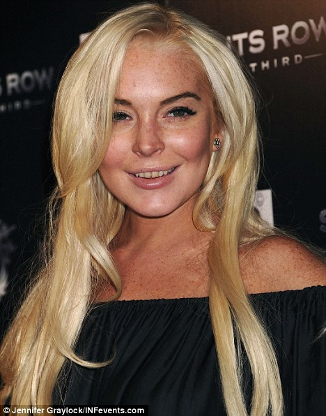Time to whiten: Lindsay Lohan was spotted with a less than Hollywood smile at the premiere of Saints Row: The Third in October