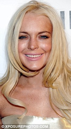 Whiter days: Lohan in 2009 with pearly whites