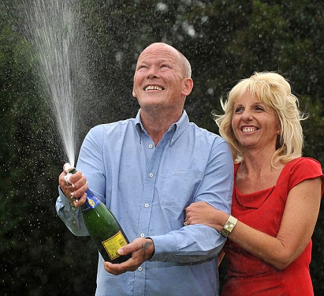 It could have been me: Winners Dave and Angela Daweskept their ticket safe to scoop £101,203,600.70