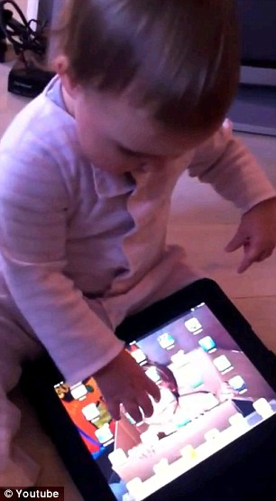 Works: The one-year-old girl has no problem playing with an iPad