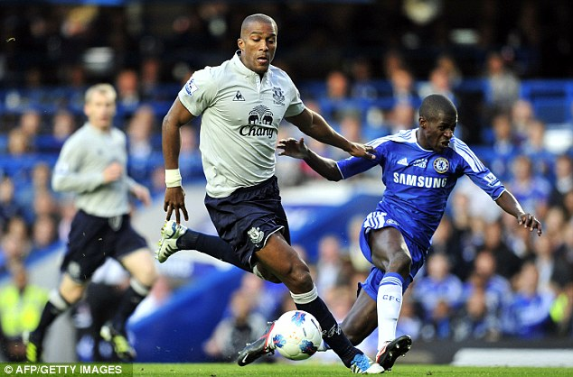 In control: Everton's Sylvain Distin (left) keeps Chelsea's Ramires at arm's length