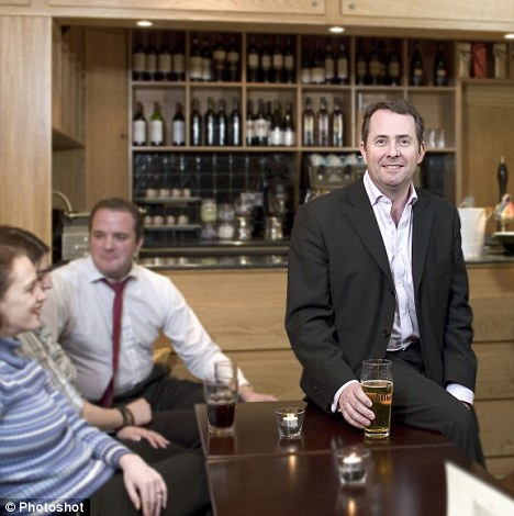 Old pals: Liam Fox (right) and Adam Werritty (left, in red tie) in March 2005 at the Bridge House Bar at Tower Bridge in London