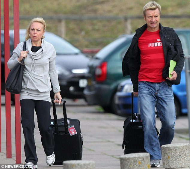 Ready to begin: Torvill and Dean look ready for action as they begin the rehearsals with this year's stars