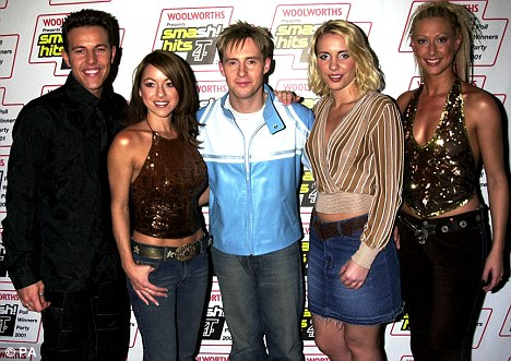 Ten years on: The group are pictured her backstage at the Smash Hits Poll Winners party weeks before their split in 2001