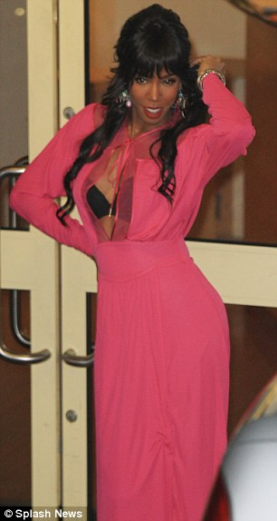 Running theme: Kelly bared her cleavage with a strange pink dress exposing her bra as she left the studio last night