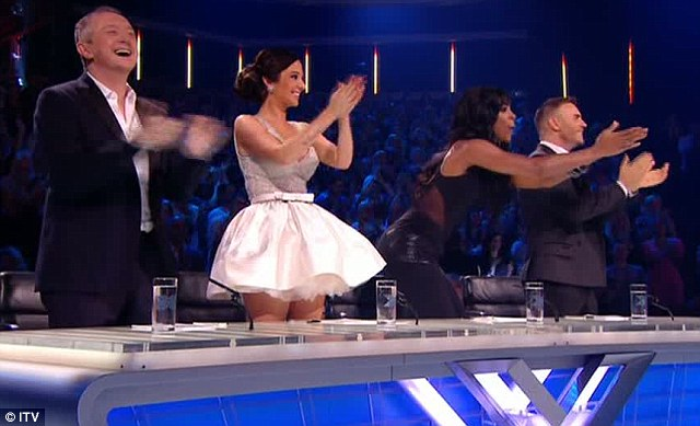 Full view: Tulisa's tiny skirt didn't come close to covering her upper legs as the judges gave a standing ovation