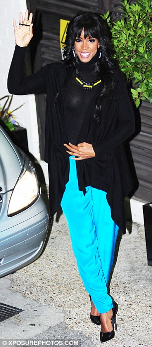 Covering up: The female judges emerged from the X Factor studios on Sunday night wearing a similar blue colour