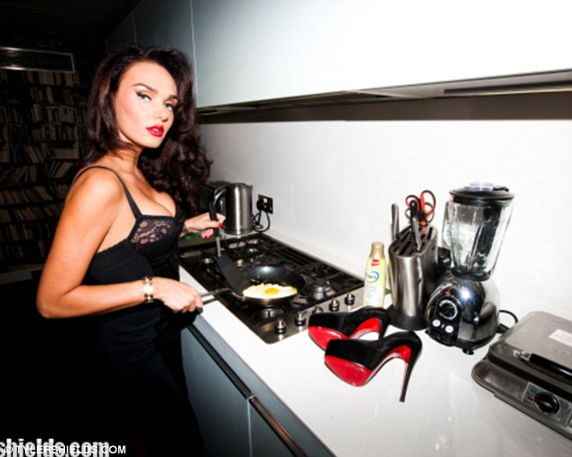 Culinary delight: Tamara fries an egg in the Tyler Shields shoot as her Christian Laboutin heels lie on the counter