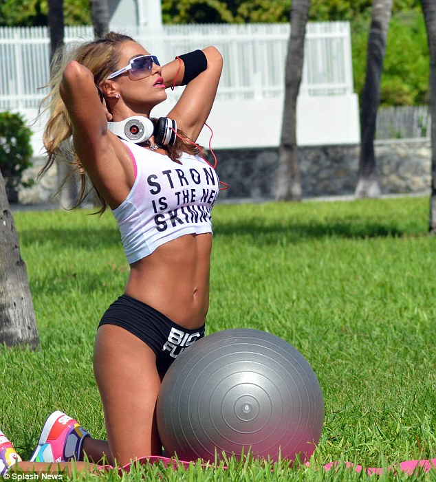 Strike a pose: Nicole put herself through the paces, all whilst preening and posing as she got busy training with her blow-up ball
