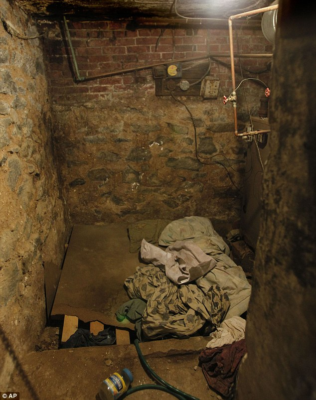Vile: Makeshift beds and dirty blankets filled the sub-basement which was home to four vulnerable individuals