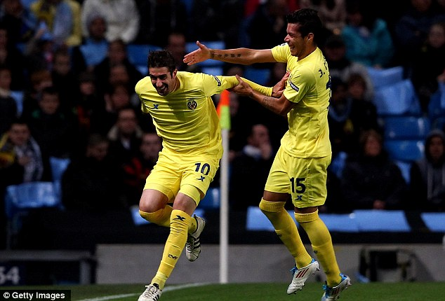 Give us a hug! Cani (left) celebrates putting his side in front inside five minutes in Manchester