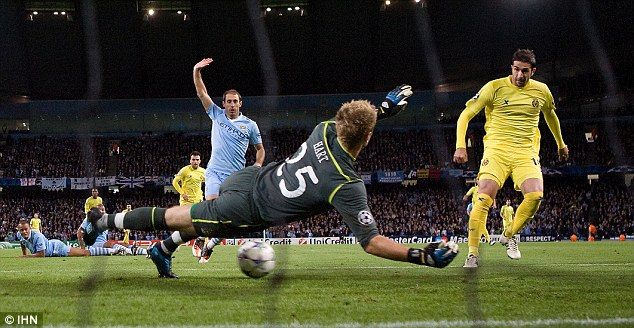 Stunning start: Cani (right) puts Villarreal in front against Manchester City