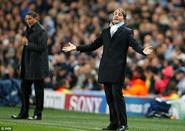In need of answers: City boss Roberto Mancini watched his side struggle against Villarreal