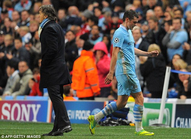 Far from happy: Adam Johnson (right) was replaced in the first half after City fell behind to Cani's early goal
