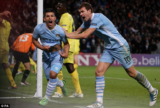 To the rescue: Sergio Aguero (left) celebrates after scoring the crucial winner for Manchester City