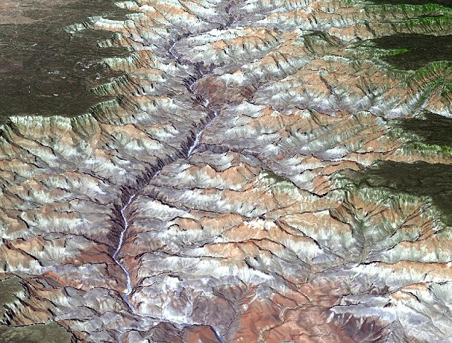 America's Grand Canyon appears in 3D in this image taken by the Aster camera aboard Terra. 99 per cent of Earth's surface is now mapped